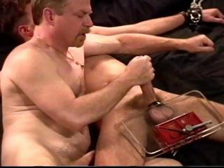 Dude in leg and feet restraints receives his ramrod and balls smashed by his slavemaster