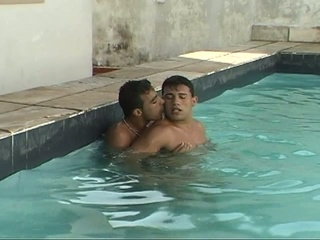 Lustful gay fellows making out in the pool