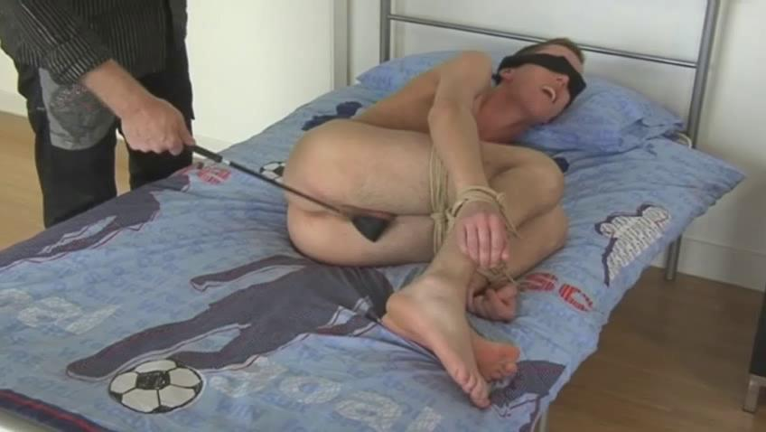 Blond gay guy receives blindfolded and spanked with a horse whip