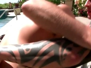 Poolside oral-job for this lascivious gay couple