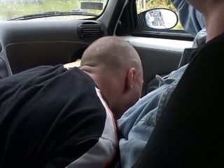 Lewd guy receives a blow job in the car