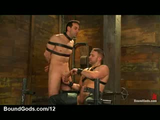 Bound gay gets tit punishment and dong jerked off in dungeon
