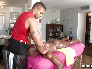 Oiled black fellow is given a tender massage by a white man. That chap pulls the masseur's 10-Pounder out and this chap begins to suck it. In what ways will this black fellow be drilled by his masseur? Will this chap give him a tip for his services?