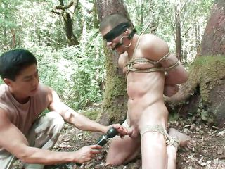 See Roderick being fastened up, blindfolded and throat gagged in the middle of the forest. This chab is bare and his juicy 10-Pounder is taunt with a sextoy after this dude gave it a mean rub. Wonder what else this chab will do to him, it will be a shame not to take advantage of his hot bare body as they are alone in the woods.