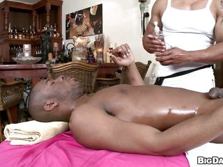 Oiled black man is getting massaged gently. This chap is being given a hand job, then that chap starts to blow his masseur. In what ways will that chap be fucked? Will his buddy return the favor or will they go str8 to the hardcore stuff?