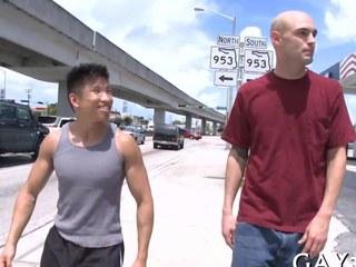 Short Oriental dude fucks a tall bald whitey out in public