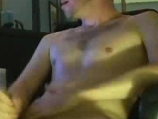 Hunky guy jerking off