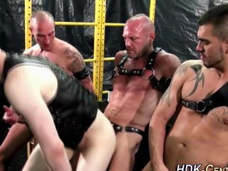 homo dudes are wearing some leather and being slavemaster