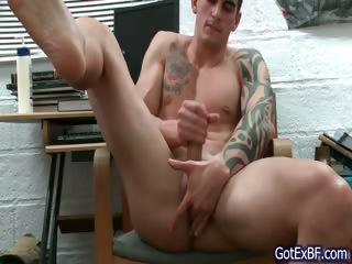 Excellent muscled and tattoed hunk jerking off