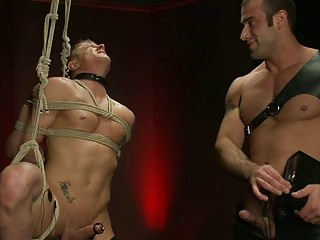 Darksome haired homosexual hunk dominates over bound abased golden-haired hunk