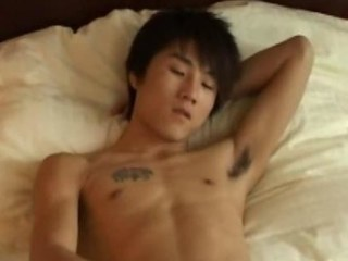 Oriental dude jerking off his large rod