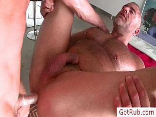 Muscled dude getting his knob rubbed by gotrub