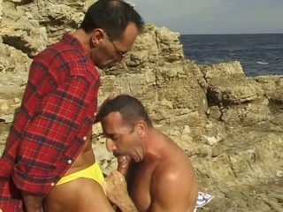 Centre aged homosexual guys sucking each other in the beach