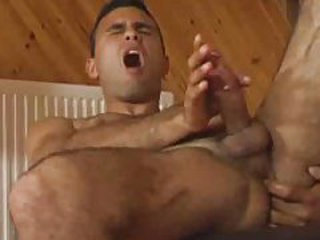 Curly fellow strokes his knob and receives it good and hard