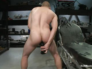 Shaved fellow masturbates during the time that stuffing his rectal hole with a big darksome sex toy. His tight ass hole barely stands that big sex toy and this stud burst with pleasure during the time that trying to set in it deeper. After this stud had sufficiently this stud lays on his back and inserts a sex toy attached on a fucking machine so this stud could acquire drilled during the time that masturbating.