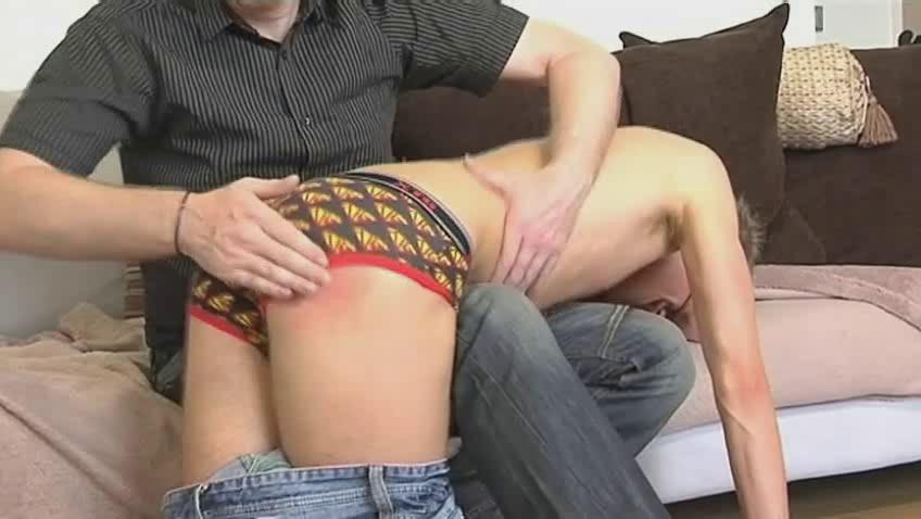 Slim homo stud receives bent over older hunks knee and spanked