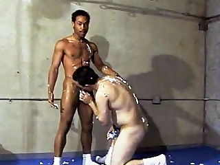 This scorching sexy homosexual interracial sex takes place in a gym, where...