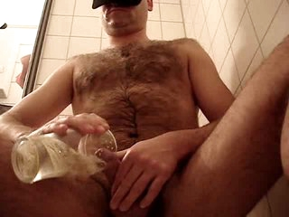 Curly stud jerks off and voids urine solo