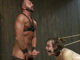 Watch this brutal executor fucking the hell out of these 2 guys. They are clamped and bound to devices. Their face holes are gagged and their butts are getting drilled by a anal machine. Executor opens one of their throat and the make him to engulf his cock. Looks like the executor is going to fuck one of them!