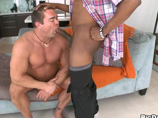 Aged stud is engulfing a long chocolate shaft and drinks his cum!