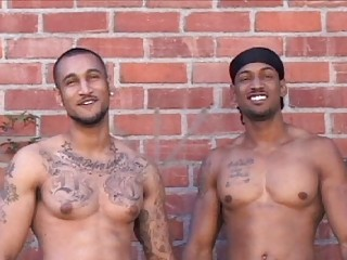 2 tattooed latin homosexual guys posing exposed outdoor