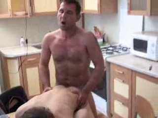 Dad bonks his chap in kitchen