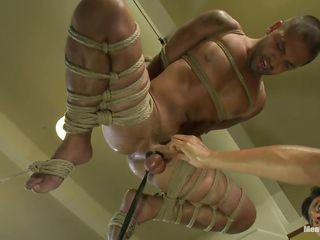 For being such a bad boy the executor bound him very constricted with a lot of rope, hanged him and fucked his ass and face hole with a large dildo. For greater pleasure and pain, this guy bound his balls real hard and gave him a firm tugjob with a lot of oil. Appear to be like Dominic enjoys the treatment his executor gives him.