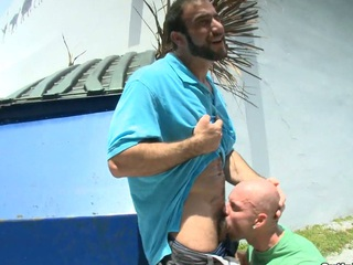 A guy with beard fucking his bald boyfriend in the face hole and ass.
