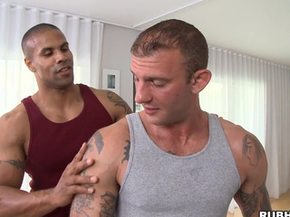 Great massage stud is showing his skills to that tattooed bodyguard