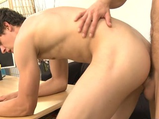 Youthful man is arousing man with salacious ramrod engulfing