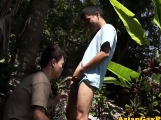 Make water drenched Asian twink sucking on a cock